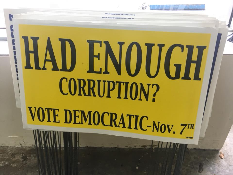 Democratic Party signs are vandalized